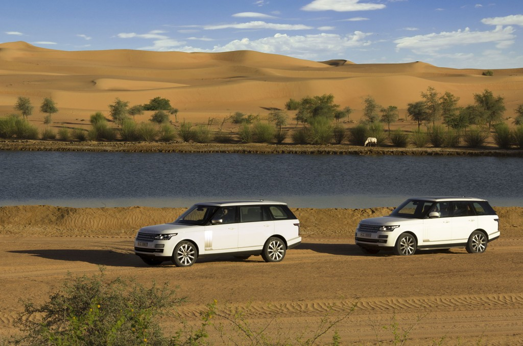 Two Range Rovers around a private lake inside the Dubai Desert Conservation Reserve